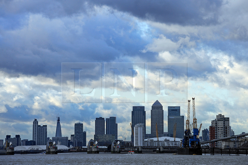 © Licensed to London News Pictures. 19/01/2012. London, UK. A view of the London Skyline from Arsenal Woolwhich Pier, featuring Canary Wharf, The Shard, the Gherkin, the O2 arena and the Thames barrier. Photo credit : Ben Cawthra/LNP