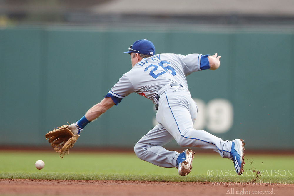 SAN FRANCISCO, CA - OCTOBER 02: Chase Utley #26 of the Los Angeles Dodgers dives for but is unable to field a ground ball hit off the bat of Joe Panik (not pictured) of the San Francisco Giants for a single during the second inning at AT&T Park on October 2, 2016 in San Francisco, California. The San Francisco Giants defeated the Los Angeles Dodgers 7-1. (Photo by Jason O. Watson/Getty Images) *** Local Caption *** Chase Utley