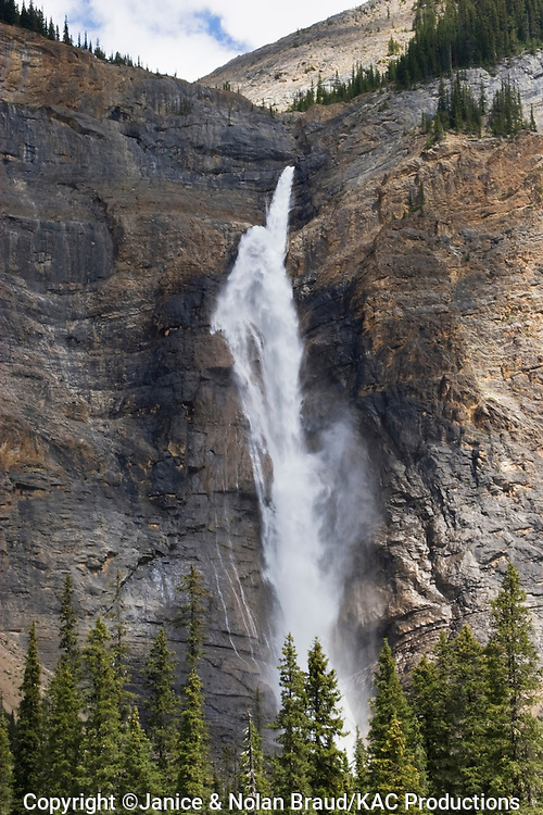 Takkakaw Falls in the Yoho National Park in British Columbia, Canada. This is a glacier fed waterfall that plunges 1016 feet from the cliff face down into Yoho Valley.