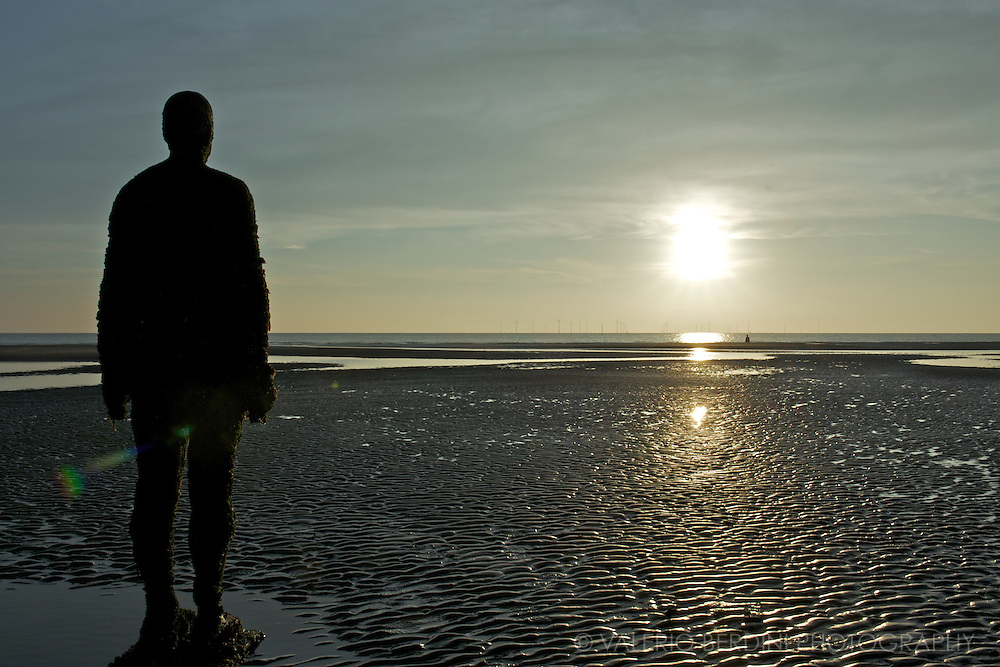 Sinking man, sinking sand, sinking sun..@ Another Place. Antony Gormley. Crosby beach, Liverpool, Merseyside. England