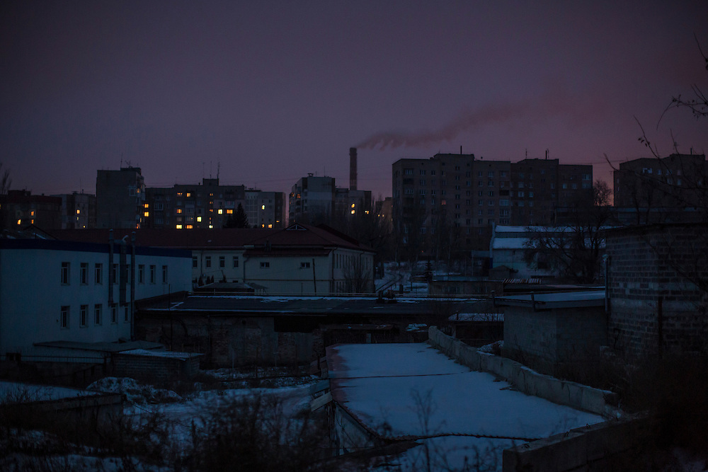 DONETSK, UKRAINE - JANUARY 26, 2015: Apartment buildings, some with electricity and somewithout, at dusk in Donetsk, Ukraine. Electricity remains spotty in certain areas of the city, and five hundred coal miners were trapped underground today when an electric station was hit by a rocket, disrupting the power supply to the mine. CREDIT: Brendan Hoffman for The New York Times