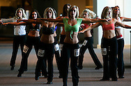 Prospective Denver Broncos cheerleaders including Jesse Adams (C) practice a routine on the first day of auditions in Denver, Colorado March 25, 2007.  Over 250 women applied for the 34 slots. REUTERS/Rick Wilking (UNITED STATES)