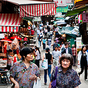 CHINA (Hong Kong). 2009. Elders in a Soho´s street market.