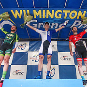 "From left: Clay Murfet, Brad White of team United Health care Pro cycling ""winner"" and Michael Stoop celebrate on the podium in front of the Grand Opera House on Market Street after winning the Men's Pro & Category I (35 miles) race for the third consecutive time in three years Saturday, May 14, 2016, in Wilmington Delaware."