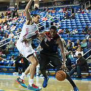 Springfield Armor Forward Willie Reed (33) drives past Delaware 87ers Center Ben Strong (44) in the course of a NBA D-league regular season basketball game between the Delaware 87ers (76ers) and the Springfield Armor (Nets) Saturday, Dec. 28, 2013 at The Bob Carpenter Sports Convocation Center, Newark, DE.