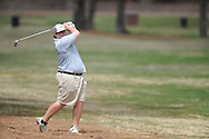 Oxford High golfer Ben Hubbard swings on the 8th hole during the MHSAA District 2-5A golf tournament at the Ole Miss Golf Course in Oxford, Miss. on Monday, April 15, 2013.