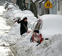 Cambridge, MA - Young-Ji Ham digs out her car from the snow on Sciarappa Street on January 28, 2010. Photo by Matthew Healey