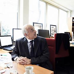 PARIS, FRANCE. MARCH 31, 2011. Economist Jean-Herve Lorenzi is the president of Le Cercle des Economistes. He is also an Advisor to the Management Board of Compagnie Financiere E. de Rothschild. Shot in his office in Paris. (photo : Antoine Doyen)