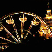 Iowa's gilded capital dome and a ferris wheel from the Fun Fair light up the night sky in Des Moines.  Des Moines, Ia.