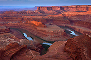 Colorado River and canyons at sunrise from viewpoint at Deadhorse Point State Park, Utah.