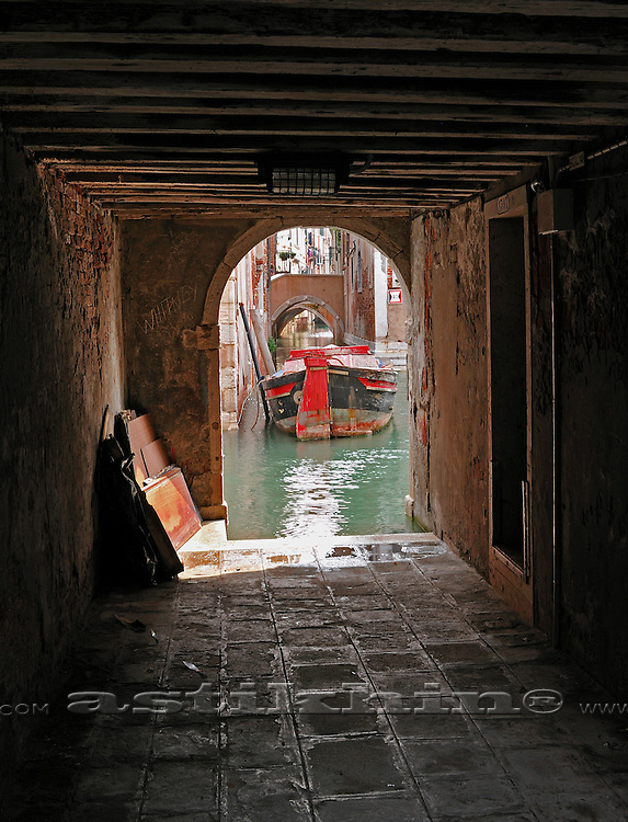 Arch, canal and boat