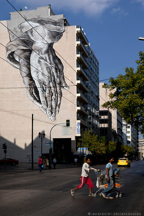 Street art by Manolis Anastasakos in the Omonoia area of Athens
