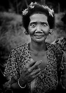 Batek Negrito woman on her way to collect herbs in the forest near the entrance to Taman Negara.  Kuala Koh, Kelantan, Malaysia.