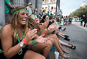 From left to right, Kelly Thompson, Shannon Davis and Michele Storey of Charleston, S.C., laugh and applaud a performance during the 191st St. Patrick's Day parade, Tuesday, March 17, 2015, in Savannah, Ga.The St. Patrick's Day tradition in Savannah dates back to the first parade held on March 17, 1824. (AP Photo/Stephen B. Morton)