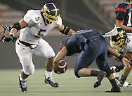 Photo by Eugene Tanner..Manti Te'o (5) of Punahou gets ready to tackle Austin Wakinekona (R) running back for Saint Louis. Punahou played the Saint Louis Saturday September 13, 2008 at the Aloha Stadium...