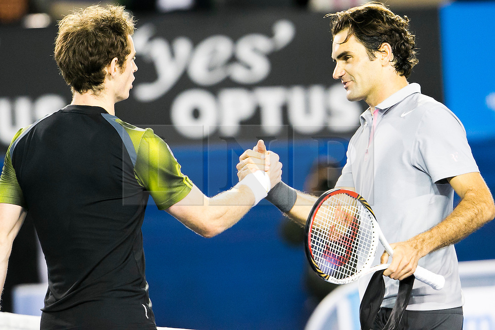 © Licensed to London News Pictures. 25/01/2013. Melbourne Park, Australia. Roger Federer shakes hands with Andy Murray after their 5 set match during the Mens Semi Final between Andy Murray Vs Roger Federer of the Australian Open. Photo credit : Asanka Brendon Ratnayake/LNP