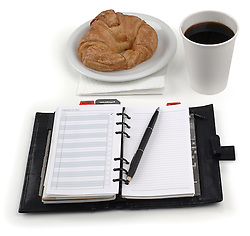 coffee, croissant & daily planner on white - with clipping path