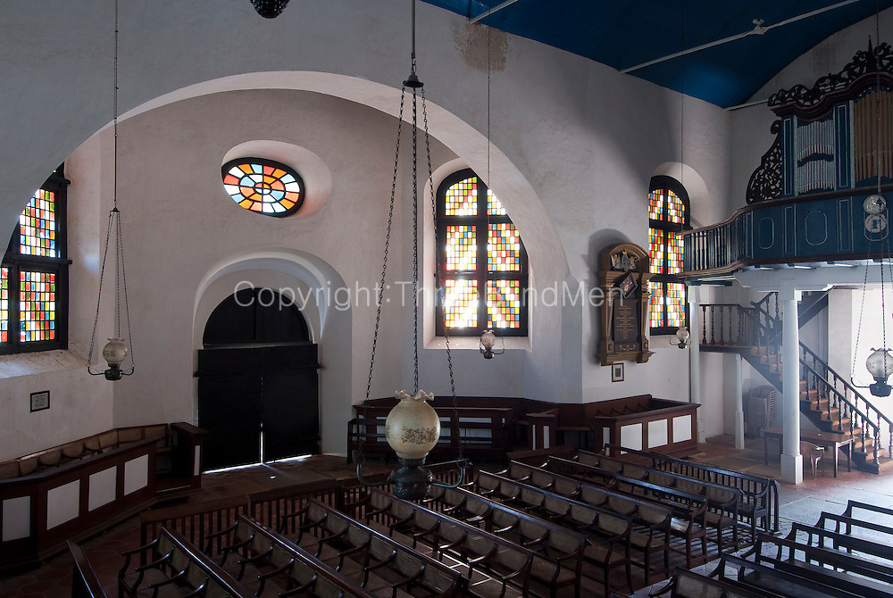 Interior of the Dutch Reformed Church in the Galle Fort. The church was built in 1640. However, it was remodelled between 1752 and 1755. The church is paved with grave stones from the old Dutch cemetery. There is an old organ of 1760 vintage in the church where services are held and a pulpit made of calamander wood from Malaysia is also used.