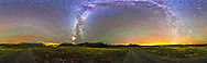 A 360&deg; panorama of the Milky Way and night sky taken at the south end of the Bison Compound in Waterton Lakes National Park, Alberta, Canada. I shot this Sept 21, 2014 on a very clear night with a faint aurora appearing to the north (right of centre) and some airglow to the north and south. The ground is lit solely by starlight. The faint glow of Gegenschein is visible at left above the road low in the south.<br />