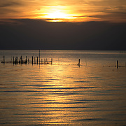 CAPE CHARLES, VA - JUNE 20: The sun sets over the Chesapeake Bay on Friday, June 20th, 2014 near Cape Charles, Va. (Photo by Jay Westcott/For The Washington Post)