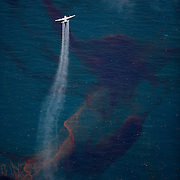 Gulf of Mexico, Louisiana (USA). May 21th, 2010. .C130 plane spraying dispersant over the oil leaked from the Deepwater Horizon wellhead in the Gulf of Mexico. The BP leased oil platform exploded on April 20 and sank after burning. Photo © Daniel Beltra/Greenpeace
