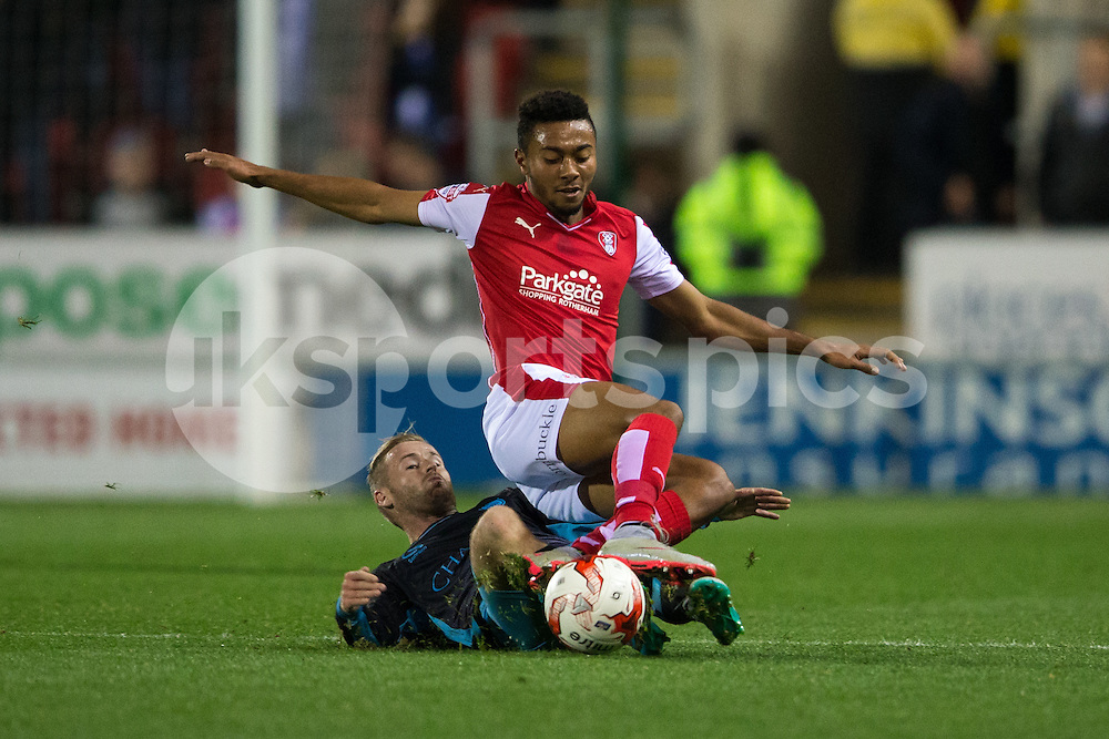 Barry Bannan of Sheffield Wednesday tackles Jonson Clarke-Harris of Rotherham United during the Sky Bet Championship match between Rotherham United and Sheffield Wednesday at the Aesseal New York Stadium, Rotherham, England on 23 October 2015. Photo by James Williamson.