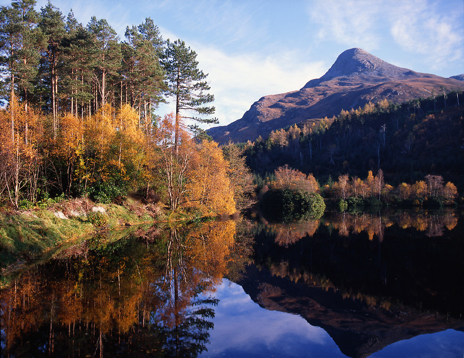 Autumn reflections of the Pap of Glencoe from across the Lochan Trail, Glencoe, West Highlands