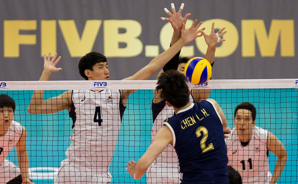 Hak-Min Kim (6) and Jin-Woo Park (4) of Korea block the spike of China's Longhai Chen (2) at a World League Volleyball match at the Sasktel Centre in Saskatoon, Saskatchewan Canada on June 26, 2016.