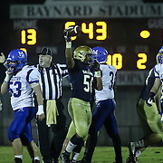 Salesianum linebacker Marek Easton (56) celebrates the recovery of a fumble in the third quarter Friday, Oct. 09, 2015 at Bernard Stadium in Wilmington, DE.