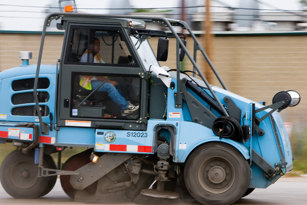 Keeping the City of Chicago clean, an Elgin street sweeper speeds down a street on the south side of the city.