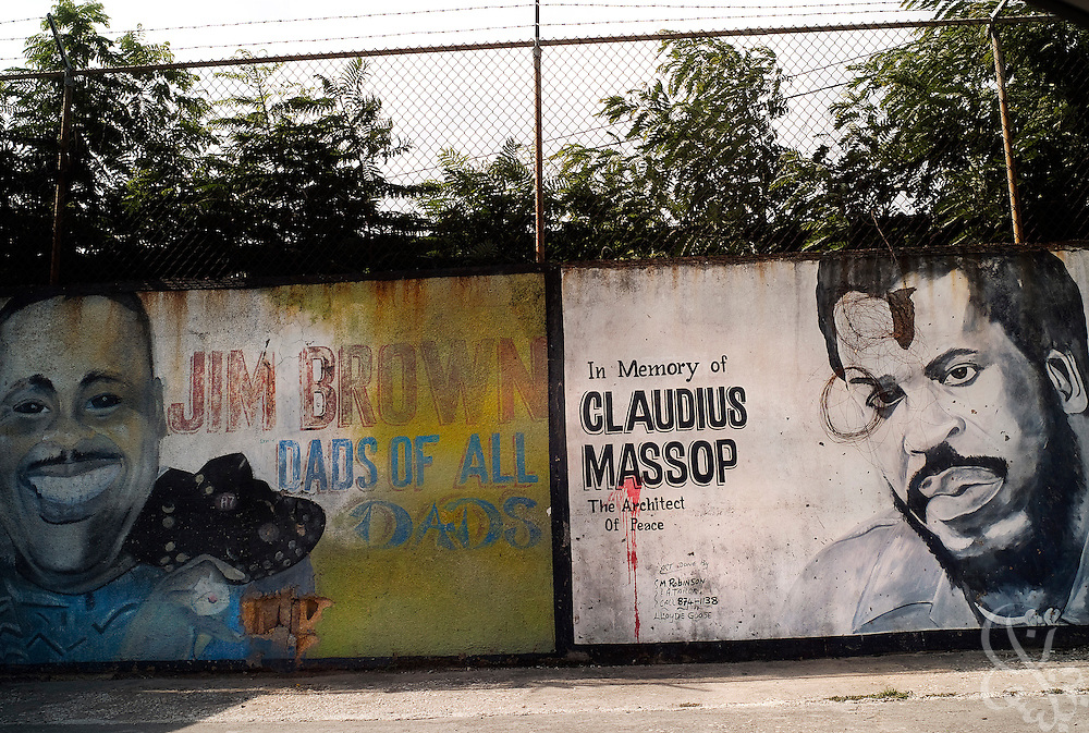 "Ghetto murals commemorate two former neighborhood gang leaders (Claudius Massop and Jim Brown), known locally as ""dons"" June 13, 2008. Both Massop and Brown were famous consecutive dons of the Tivoli Gardens neighborhood in Kingston during the 70's and 80's. In the vacuum created by state neglect, Jamaica's inner city communities have come to rely on dons to provide what the state does not, namely employment, social aid, and even rudimentary courts to handle transgressions of gang law within communities."