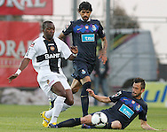 Portugal, FUNCHAL : Nacional's Angolan forward Mateus Costa (L) vies with Porto's Argentinian midfielder Lucho Gonzales (C) and Belgian midfielder Steven Defour (R) during their Portuguese football match at Madeira Stadium in Funchal on March 16, 2012. .PHOTO/ GREGORIO CUNHA.Estadio da Madeira, Funchal, Liga Portuguesa de futebol, Nacional vs Porto. .Mateus, Lucho e Defour