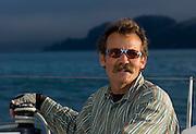Captain Stan at the helm. Sailing on San Francisco Bay,,in a 39foot Catamaran.