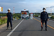 Keep away sign and police at a roadblock in Minami Soma that stops cars from going to the 20 km zone from the nuclear plant unless they have a special permission.