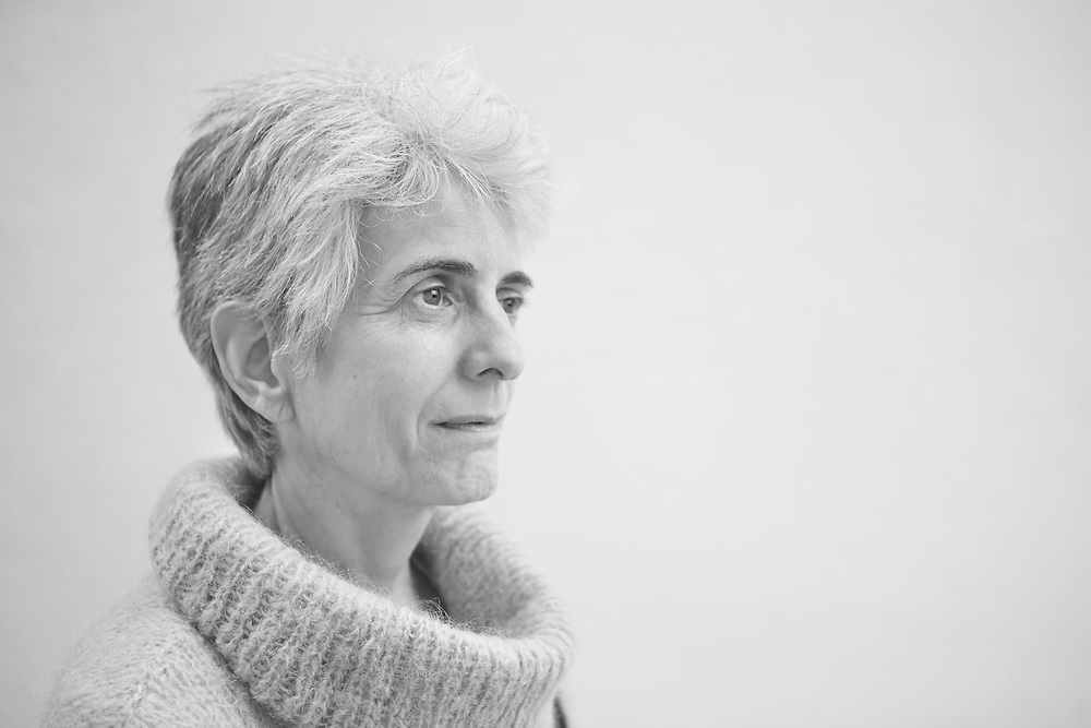 Black and white portrait photograph of woman in deep reflection