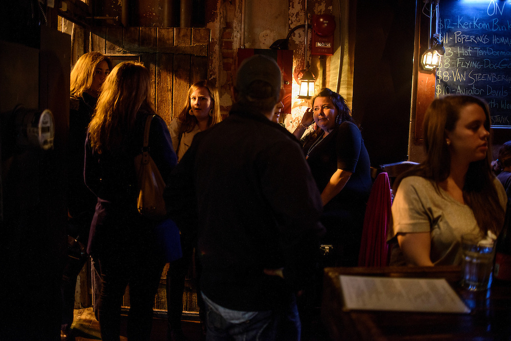 Photo by Matt Roth.Assignment ID: 10137081A..Patrons enter Granville Moore's bar and restaurant on H Street, N.E., in Washington, D.C. on Saturday, January 12, 2013...H Street, N.E, in Washington D.C. was recently ranked sixth on Forbes magazine's list of the nation's best hipster neighborhoods.