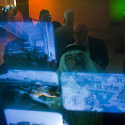 A guest looks at an interactive exhibit during the inauguration of King Abdullah University of Science and Technology (KAUST) on September 23, 2009, in Thuwal, Saudi Arabia (80 kilometers north of Jeddah). KAUST is a graduate-level research institution that has attracted top scientists and students from around the world.