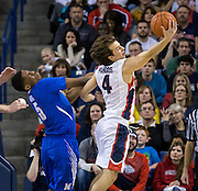 Gonzaga's Kevin Pangos(4) grabs a rebound over Memphis' Nick King(5) in the first half of play at the McCarthey Athletic Center in Spokane, WA, Saturday, Jan. 31, 2015. (Ryan Sullivan/Gonzaga University)