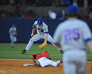 Mississippi's Tim Ferguson steals second as Florida's Nolan Fontana applies the tag at Oxford-University Stadium on Friday, March 26, 2010 in Oxford, Miss. Ole Miss won 3-2.