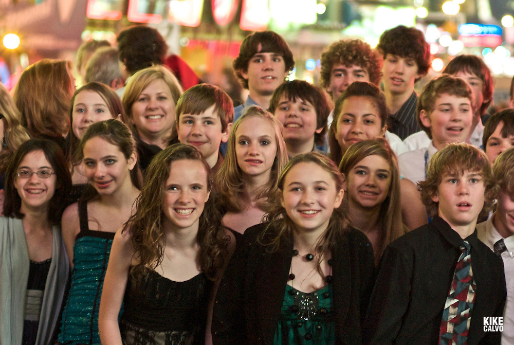 Times Square teather area at nigh, heart of all New York Broadway showsGroup of out of town teen tourists visiting New York all dressed up