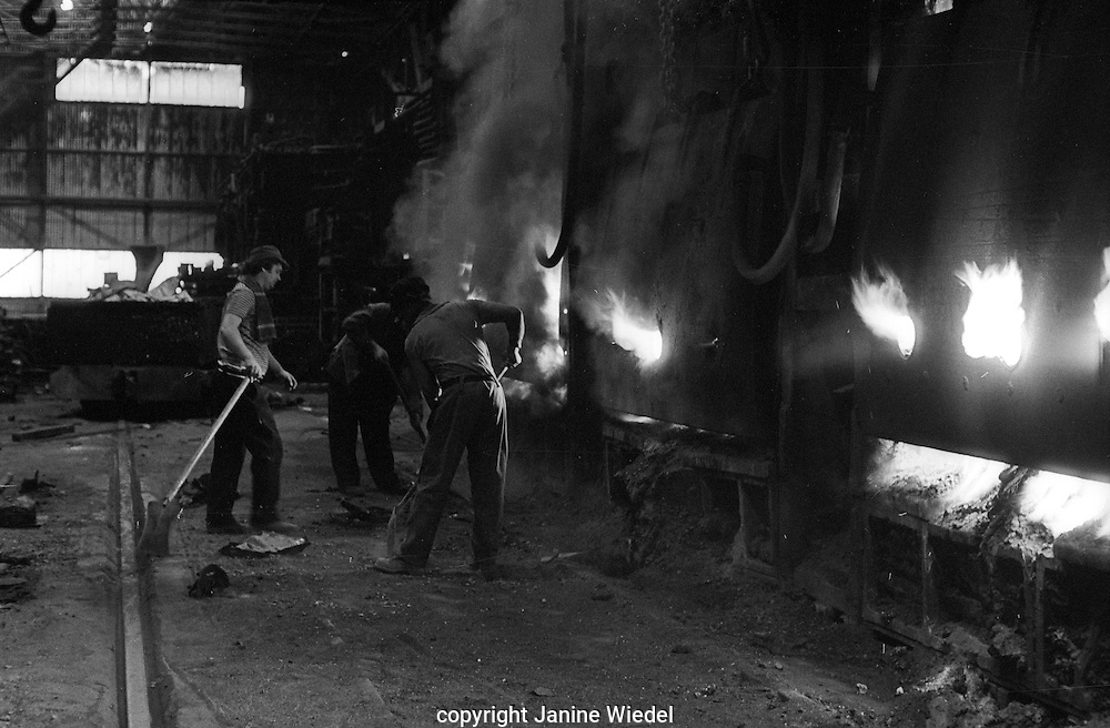 Watching & testing molten mixture being turned into steel Bilston Steelworks Open Hearth furnace  in the Black Country West Midlands in the 1978