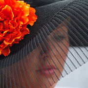 Sarah Risch of Louisville, Ky., wears a hat at the the 133rd Kentucky Derby at Churchill Downs in Louisville Saturday, May 5, 2007