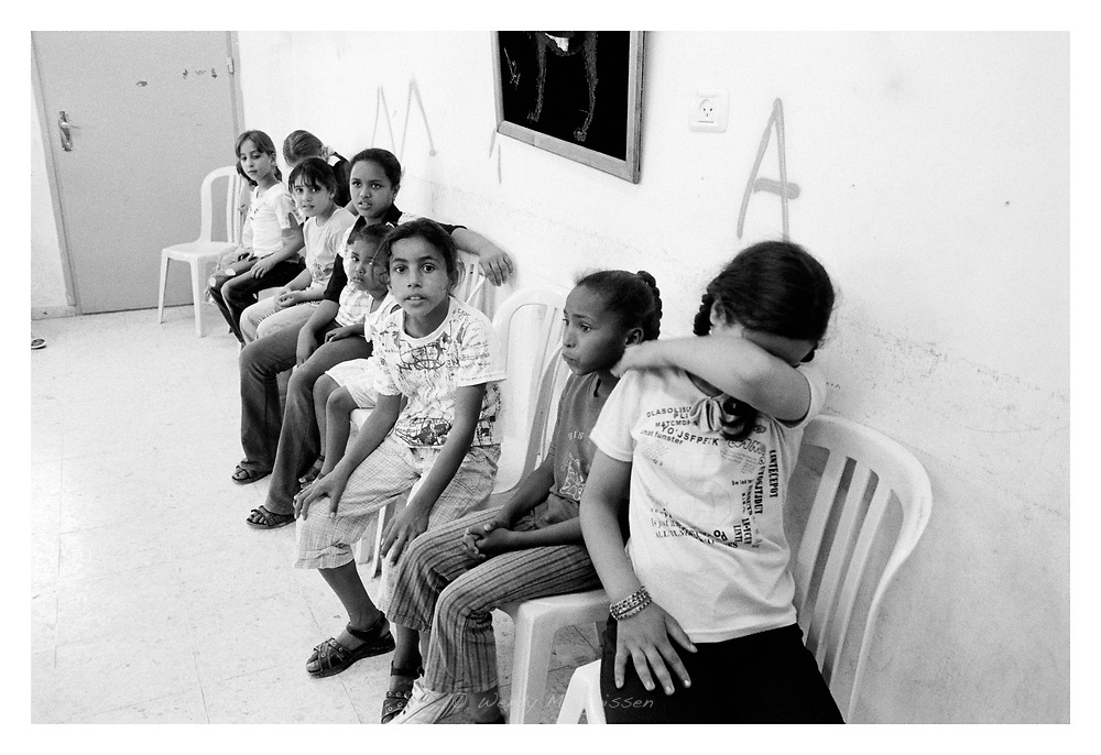 Young girls waiting around to attend a concert  at the Re-education centre at Askar refugee camp. Nablus, Palestine, 2007