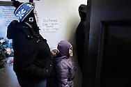 """OHIO, Toledo, October 27, 2012:  Persons standing on line inside the basement of the  """"Primera Iglesia Bautista"""" in Toledo where food and used clothes are distributed to help homeless and people living under the poverty line. ALESSIO ROMENZI"""