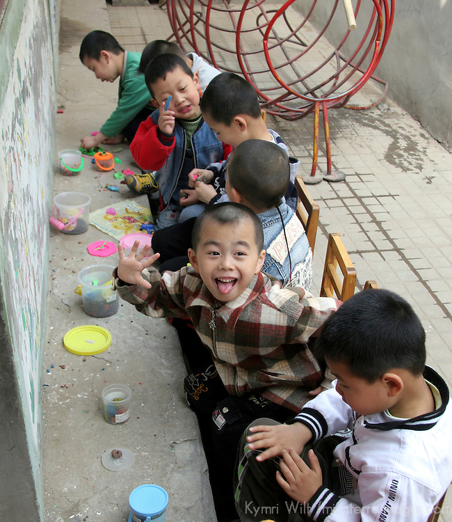 Asia, China, Beijing. Chinese kindergarten children with playdoh.