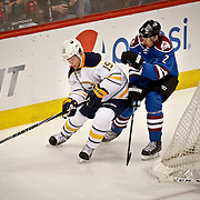 SHOT 3/28/15 8:16:13 PM - The Colorado Avalanche's Nick Holden #2 plays defense against the Buffalo Sabres' Cody Hodgson #19 during their regular season NHL game at the Pepsi Center in Denver, Co. The Avalanche won the game 5-3. (Photo by Marc Piscotty / © 2015)