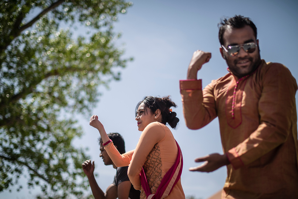 rer041317b/metro/04.13.2017/Roberto E. Rosales <br /> UNM students were treated to international delights as the campus celebrated the International Festival.  Pictured are students from Bangladesh Nayyar Rima(Cq),center, and Bashir Safeeul(Cq) ,right, performing during a dance at lunchtime. . <br />  Albuquerque, New Mexico(Roberto E. Rosales/Albuquerque Journal)