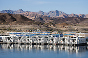 Houseboats line the dock at Callville Bay Marina, Lake Mead National Recreation Area, Nevada, USA. Formation of Lake Mead began in 1935, less than a year before Hoover Dam was completed along the Colorado River. The area surrounding Lake Mead was established as the Boulder Dam Recreation Area in 1936. In 1964, the area was expanded and became the first National Recreation Area established by US Congress. Three desert ecosystems meet in Lake Mead NRA: Mojave Desert, Great Basin Desert, and Sonoran Desert. The panorama was stitched from 9 overlapping photos.
