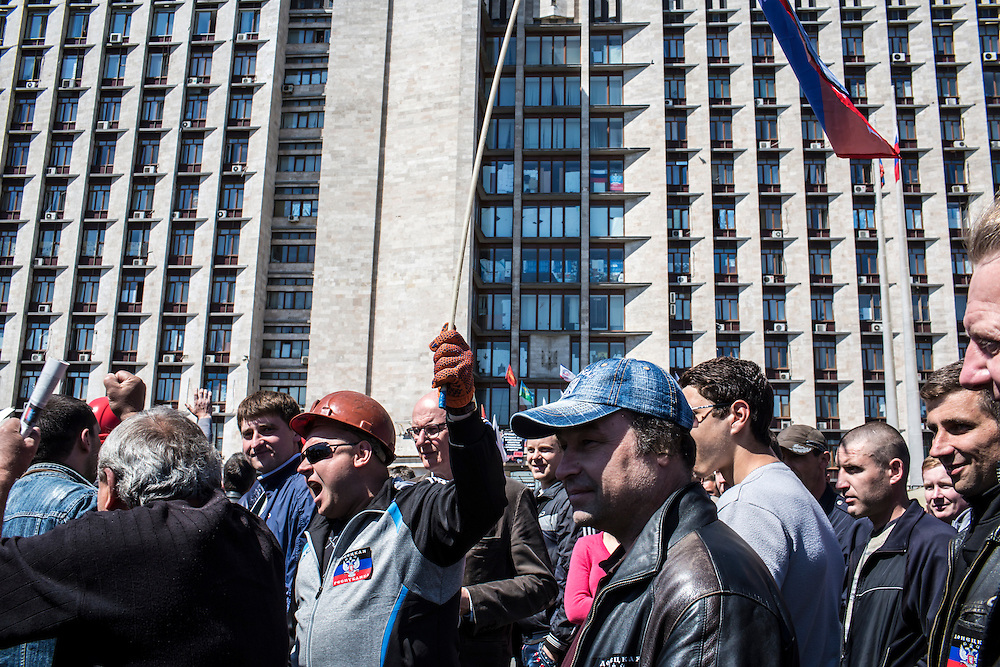 DONETSK, UKRAINE - MAY 7: A group of miners rallies in front of the regional administration building, which is occupied by pro-Russian protesters, to support a movement for greater autonomy from the government in Kiev on May 7, 2014 in Donetsk, Ukraine. Tensions in Eastern Ukraine are high after pro-Russian activists seized control of at least ten cities and ahead of the Victory Day holiday and a planned referendum on greater autonomy for the region. (Photo by Brendan Hoffman/Getty Images) *** Local Caption ***