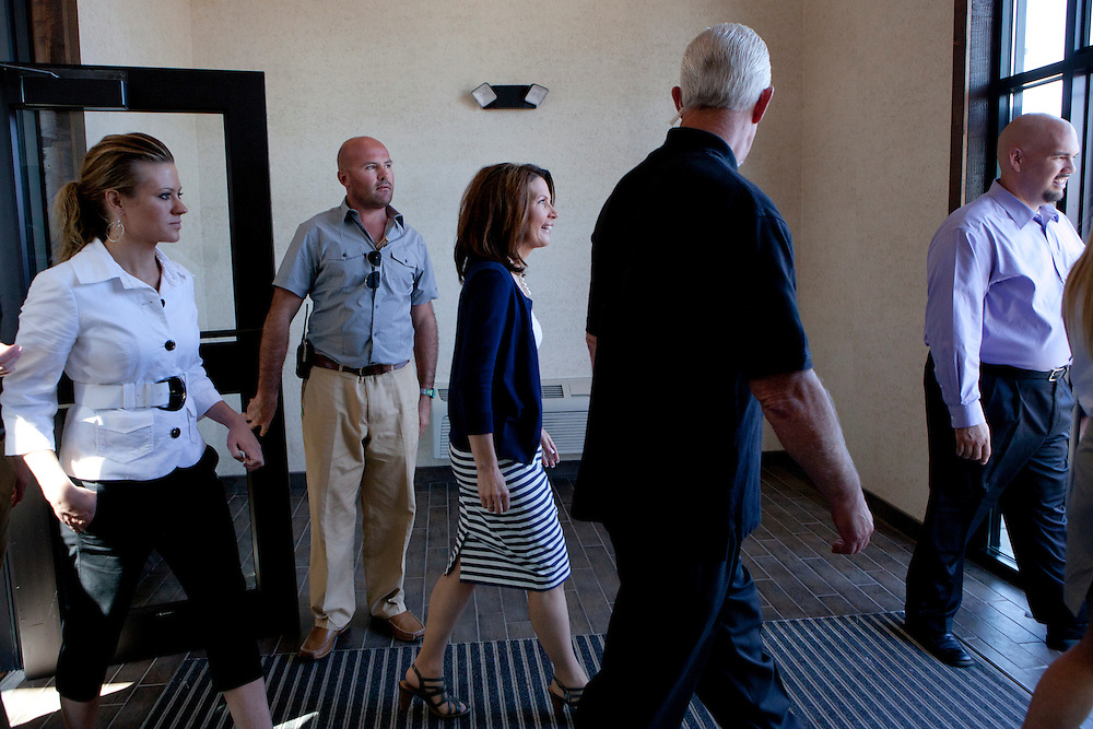 Republican presidential hopeful Michele Bachmann, center, departs a campaign stop on Tuesday, August 9, 2011 in Sioux City, IA.